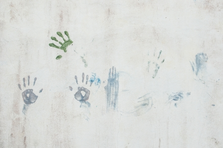 Hand caused by the colors on the wall photo