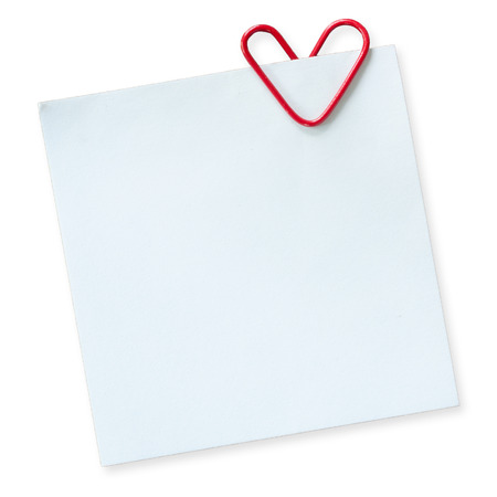 Note and heart shaped paper clip on a white background Stockfoto