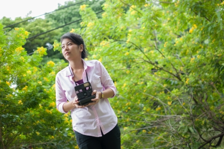 Leisure activities of girl photographers in fine weather photo