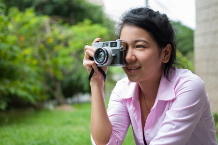Leisure activities of girl photographers in fine weather