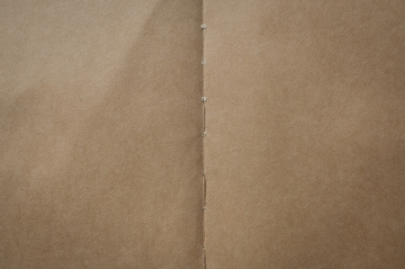crease: One sepia paper in a old book Stock Photo