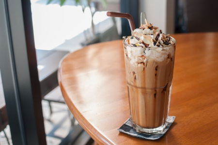Iced coffee with whipped cream and sprinkle with almonds
