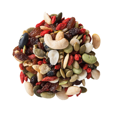 Organic mixed nuts on a white background photo