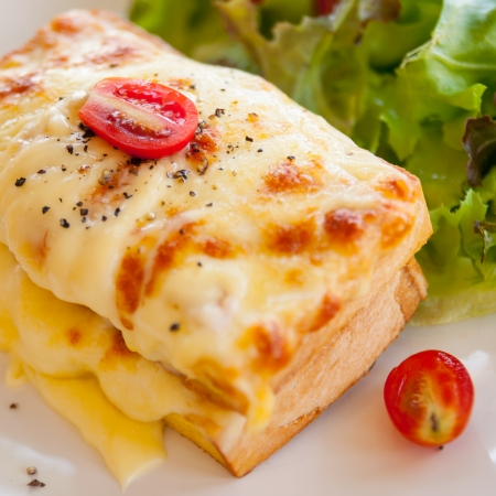 French toast ham cheese and salad on dish