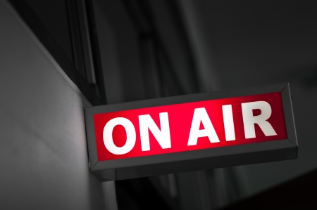 on air sign: ON AIR board message is lit on in studio