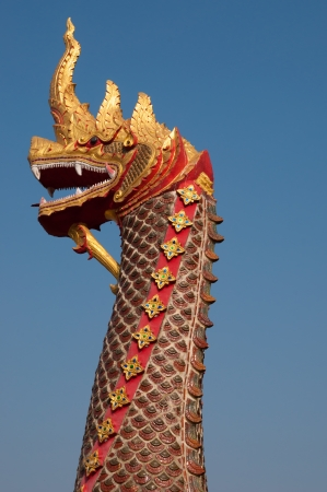 King of Nagas statue on blue isolated background photo