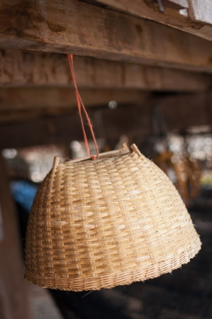 Basket of Thailand is hung inside the house photo