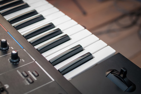 Music Synthesizer closeup. keyboard and controls photo