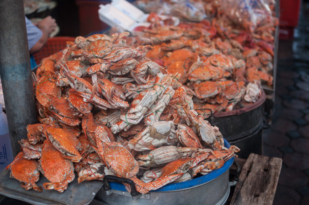 Steamed sea crab on a stall in the market. photo