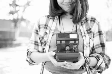 Film camera in the hands of women photo