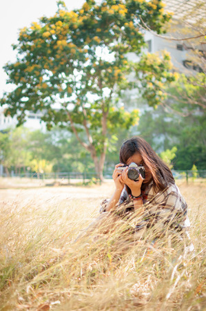 Leisure activities of girl photographer in fine weather photo