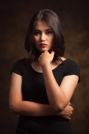 Glamorous young sexy woman on brown background