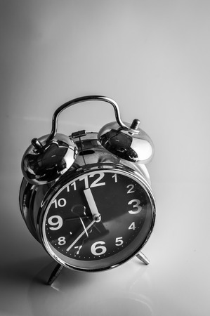 Closeup of classical alarm clock on white background photo