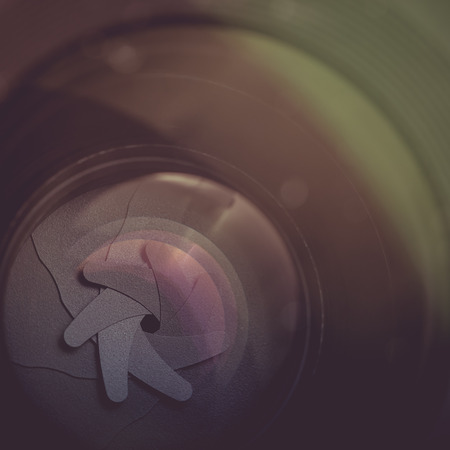 The diaphragm of a camera lens aperture. Selective focus with shallow depth of field. Color toned image photo