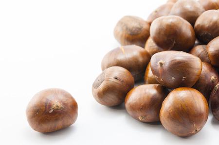 Sweet chestnuts isolated on white background photo