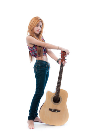 Glamorous young woman with her guitar on a white background photo