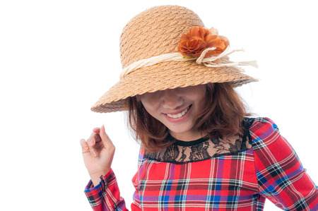 Glamorous young woman in a red shirt with her hat on a white background photo