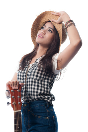 Glamorous young woman in a plaid shirt with her guiter on a white background photo