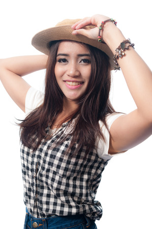 Glamorous young woman in a plaid shirt with her hat on a white background photo