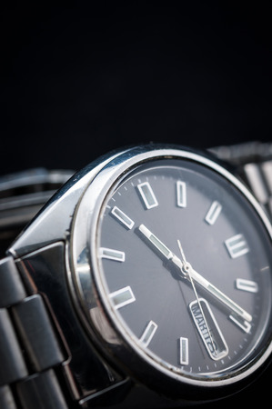 Closeup of classic watch on black background photo