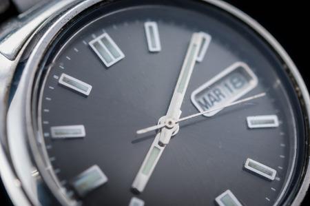 chrome man: Closeup of classic watch on black background