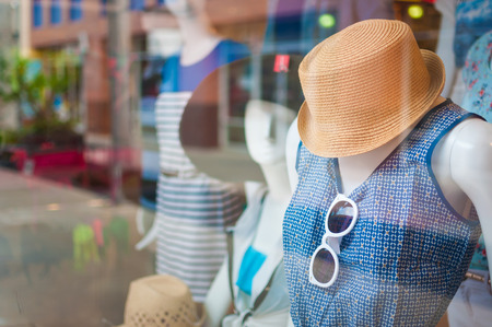 Female mannequins inside a fashion house