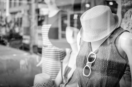black glass: Female mannequins inside a fashion house, Black & White image