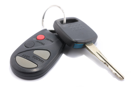 Car key with remote control isolated on whitebackground photo