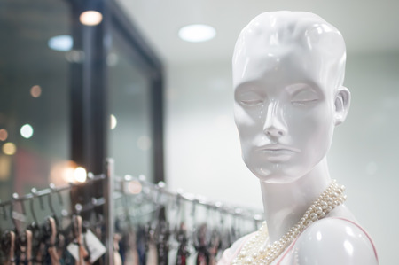 Female mannequins inside a fashion house
