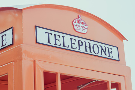 color effect: Orange telephone booth and mail box, Color effect Stock Photo