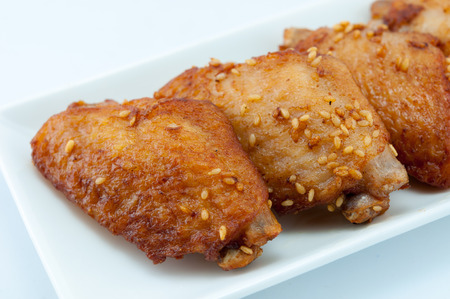 junk food: Studio photography of a fried chicken wings on whith dish