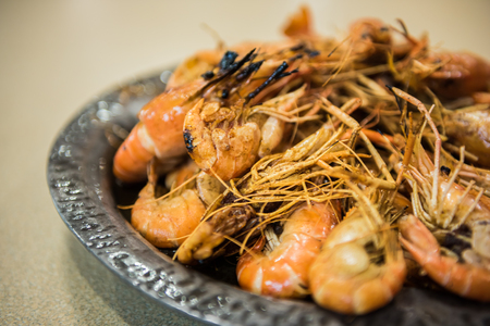 Large shrimp deep fried with hot oil Stock Photo