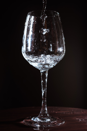 Flowing action of water splash out of Wine Glasses, One part of celebration,ceremony or party