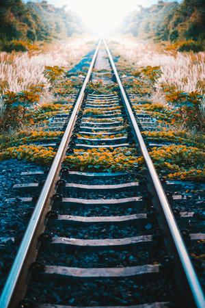 Train platform at sunset. Railroad in Ukraine. Railway landscape, Color effect image