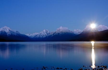 mcdonald: Moon Comming up over lake Mcdonald In Glacier National Park  Stock Photo