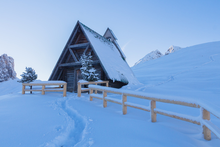 Chapel in a snowy landscape of the Dolomites Banco de Imagens