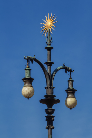 Baroque lamp with ornament of gold-plated sun. Prague. Stock Photo