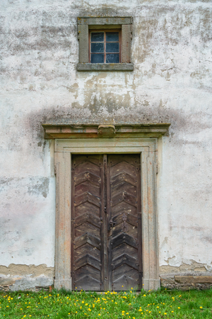 Old wooden church door and window