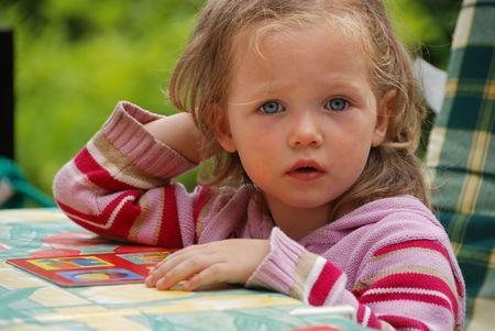 kiddies: girl thinking Stock Photo