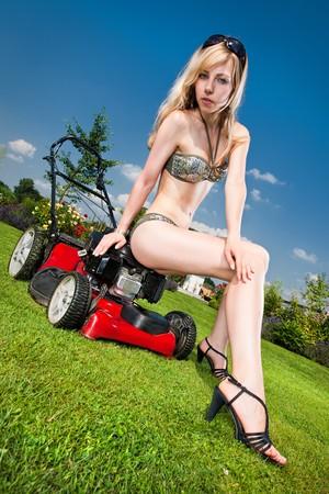 mower: woman on a lawn mower