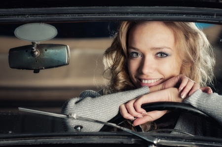 pretty woman in an old car