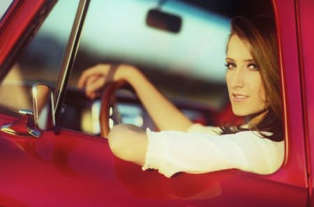 cool girl: driving seventies Stock Photo