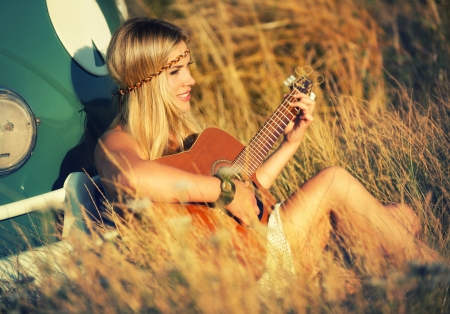 girl playing guitar: Suzi s singin  a summer song