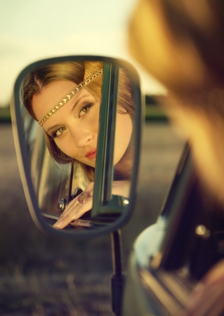 pretty woman s face in a mirror photo