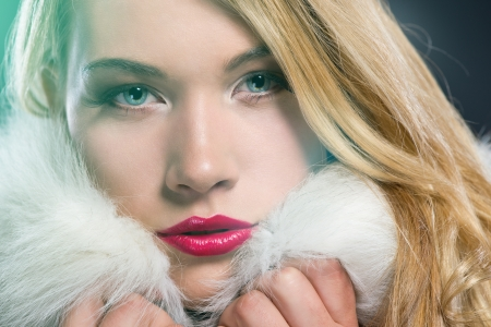 Pretty blonde woman in winter coat photo