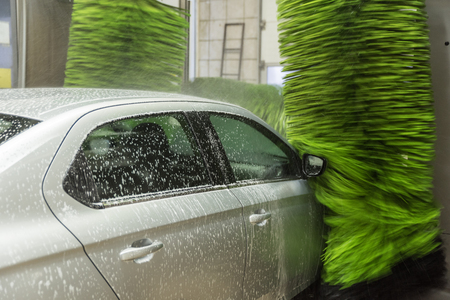 washing cars with pressurized water, washing with foam and water, car wash 写真素材