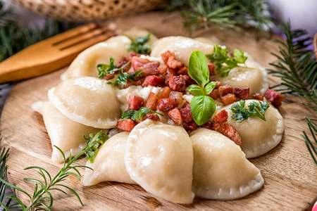 Potato gnocchi stuffed with bacon on a wooden table, Traditional Slovak cuisine mountain view
