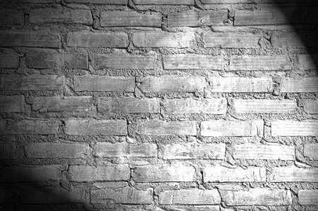 Spotlight on the brick wall photo