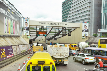 HONG KONG - JUNE 21  Vehicles are crossing from Hongkong Island to Kowloon on June 21, 2013 in Hong Kong  The Cross-Harbour Tunnel is the first tunnel in Hong Kong built underwater  Editorial