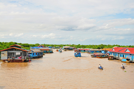 The floating village on the water of Tonle Sap lake, Cambodia  photo